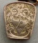 Locket with initials of 'JL'